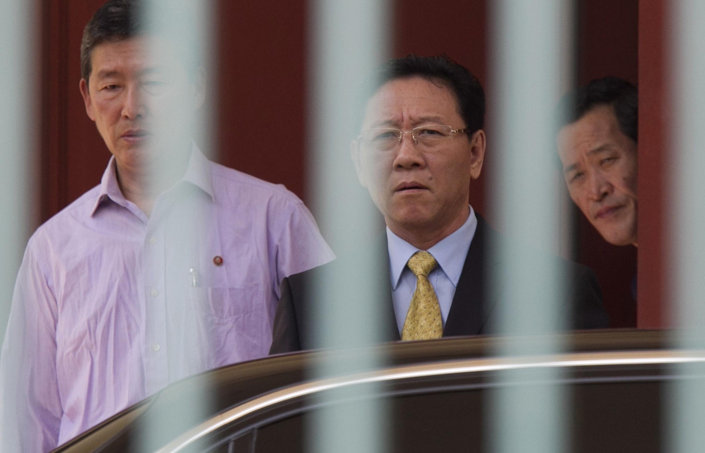 North Korean Ambassador to Malaysia Kang Chol (C) prepares to get on a car at the embassy in Kuala Lumpur, Malaysia on March 6, 2017. (AP Photo/Daniel Chan)