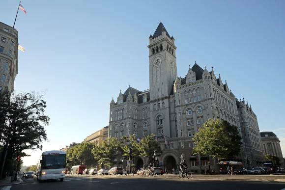 Morning traffic flows past the Trump International Hotel on its first day of business on Sept. 12, 2016 in Washington. The Trump Organization was granted a 60-year lease to the historic Old Post Office by the federal government before Trump announced his intent to run for president. The hotel has 263 luxury rooms, including the 6,300-square-foot 'Trump Townhouse' at $100,000 a night, with a five-night minimum. (Chip Somodevilla/Getty Images)