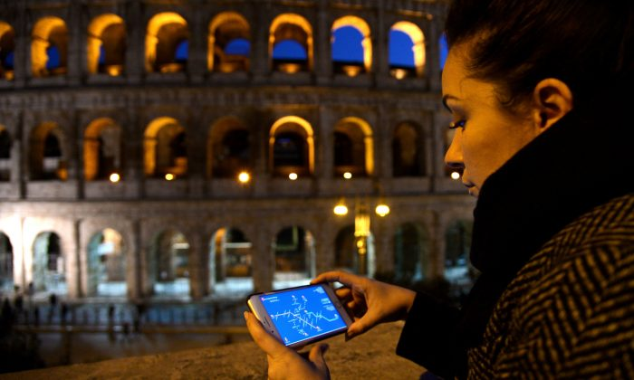 A woman with a smartphone in Rome, Italy, Feb. 14, 2017. (Filippo Mmonteforte/AFP/Getty Images)