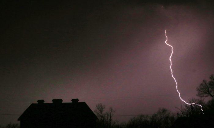 Lightning strikes near the barn on the Taylor farm near Lawrence, Kan., on March 6, 2017. (AP Photo/Orlin Wagner)