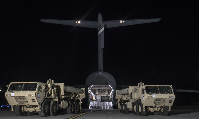 Trucks carrying U.S. missile launchers and other equipment needed to set up the Terminal High Altitude Area Defense (THAAD) missile defense system arrive at the Osan air base in Pyeongtaek, South Korea on March 6, 2017. (U.S. Force Korea via AP)