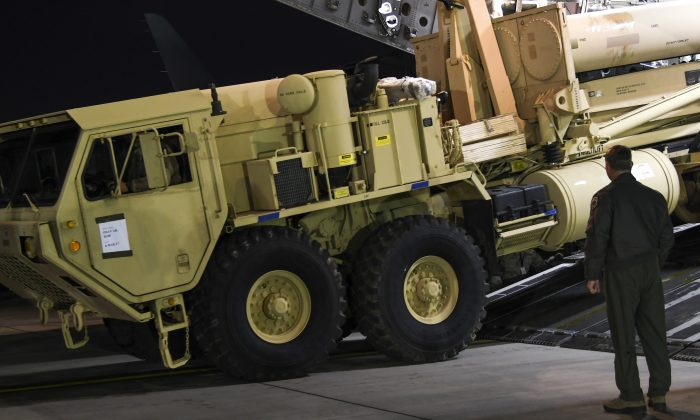 A truck carrying parts of U.S. missile launchers and other equipment needed to set up the Terminal High Altitude Area Defense (THAAD)  missile defense system arrive at Osan air base in Pyeongtaek, South Korea on March 6, 2017. (U.S. Force Korea via AP)