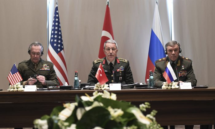 Turkey's Chief of Staff Gen. Hulusi Akar (C) U.S. Chairman of the Joint Chiefs of Staff Gen. Joseph Dunford (L) and Russia's Chief of Staff Gen. Valery Gerasimov attend a meeting in the Mediterranean coastal city of Antalya, Turkey, on March 7, 2017. (Turkish Military, Pool Photo via AP)