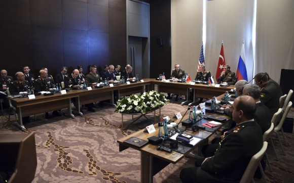 Turkey's Chief of Staff Gen. Hulusi Akar (C) U.S. Chairman of the Joint Chiefs of Staff Gen. Joseph Dunford (L) and Russia's Chief of Staff Gen. Valery Gerasimov and their delegations attend a meeting in the Mediterranean coastal city of Antalya, Turkey on March 7, 2017. Turkey's military says the Turkish, U.S. and Russian chiefs of military staff are meeting in southern Turkey to discuss developments in Syria and Iraq. The meeting comes amid renewed Turkish threats to hit U.S.-backed Syrian Kurdish targets in the northern Syrian city of Manbij. (Turkish Military, Pool Photo via AP)