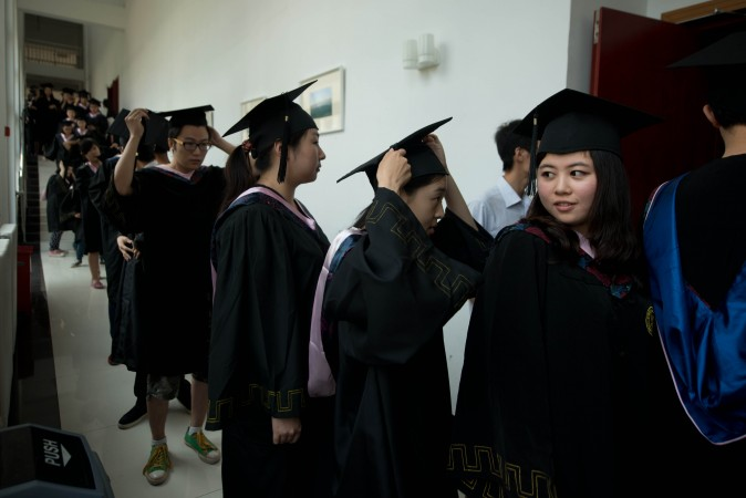 Students line up to receive their degree certificates at the private Kade College Capital Normal University on the outskirts of Beijing on June 26, 2013. (Ed Jones/AFP/Getty Images)