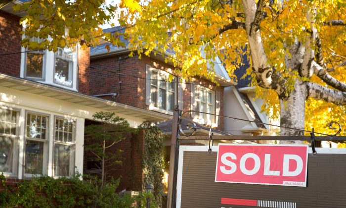 A sold sign in front of a west-end Toronto property on Nov. 4, 2016. (The Canadian Press/Graeme Roy)