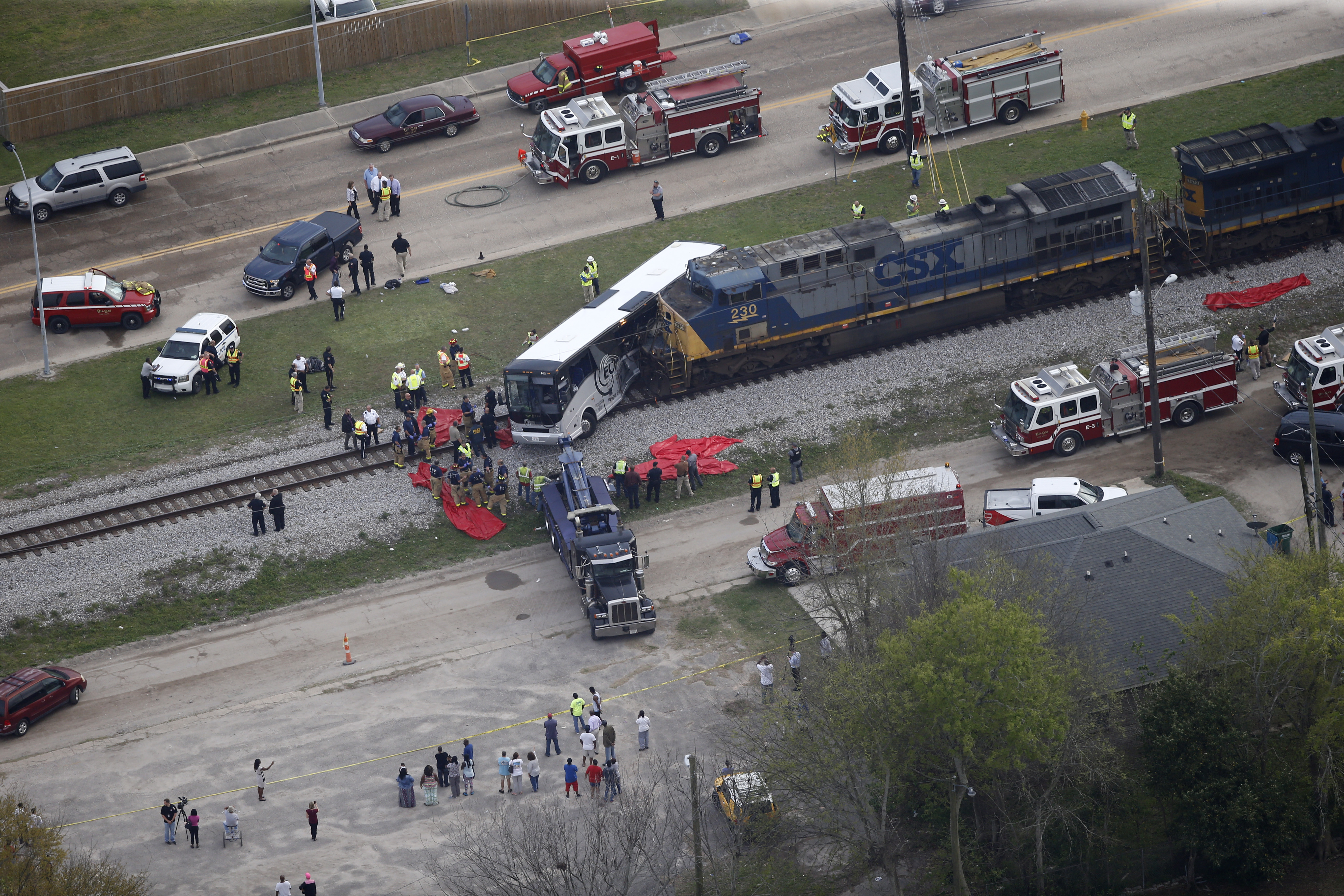 Responders works the scene where a train hit a bus in Biloxi, Miss., on March 7, 2017. (AP Photo/Gerald Herbert)