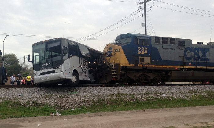 A freight train smashed into a charter bus in Biloxi, Mississippi, on March 7, 2017,  pushing the bus 300 feet down the tracks authorities said. (AP Photo/Kevin McGill)