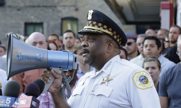 Chicago Police Superintendent Eddie Johnson speaks with with residents of Chicago, in this file photo. (AP Photo/Teresa Crawford)