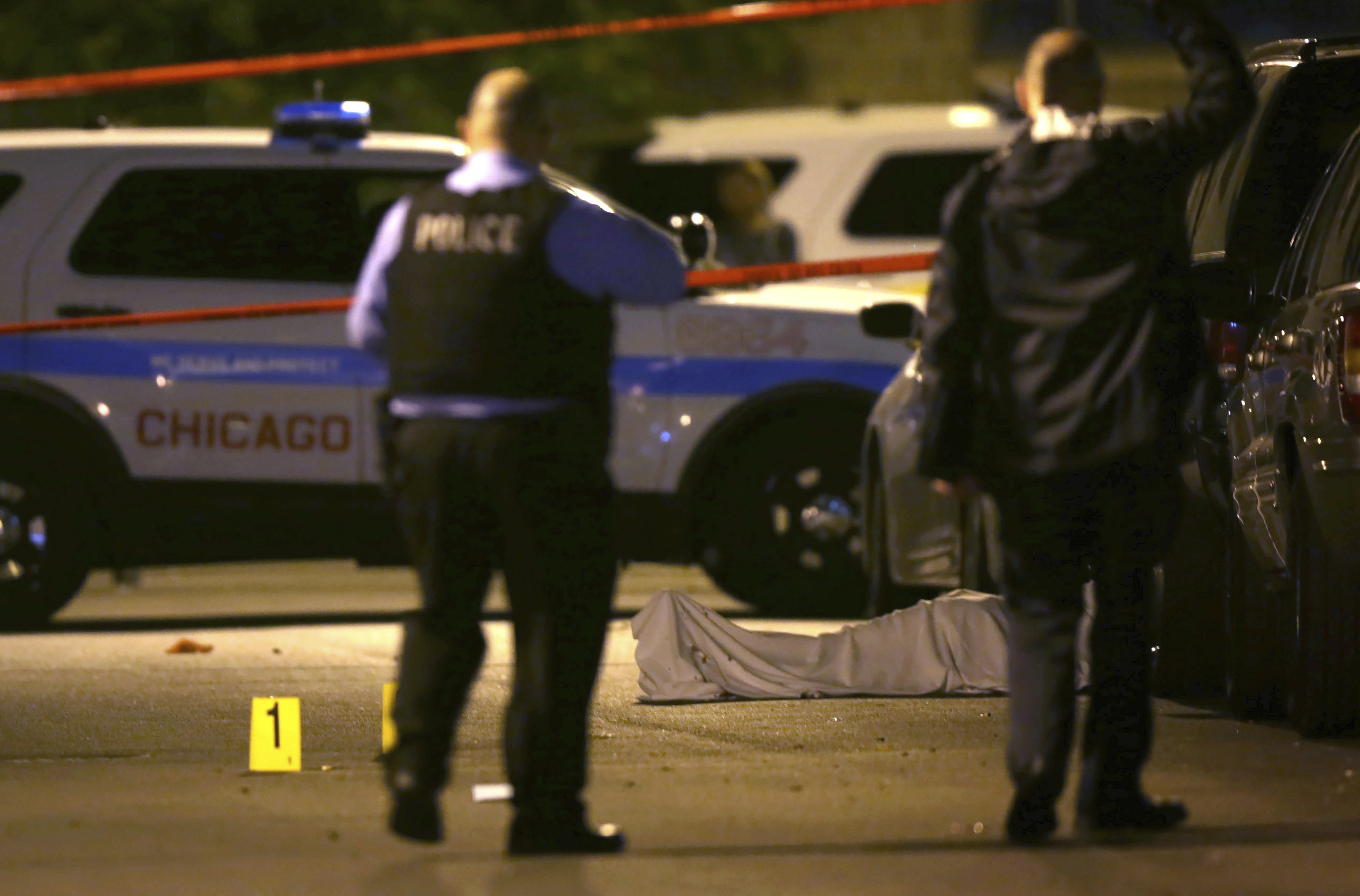 Police work  the scene where a man was fatally shot in the chest in Chicago, in this file photo. (E. Jason Wambsgans/Chicago Tribune via AP)