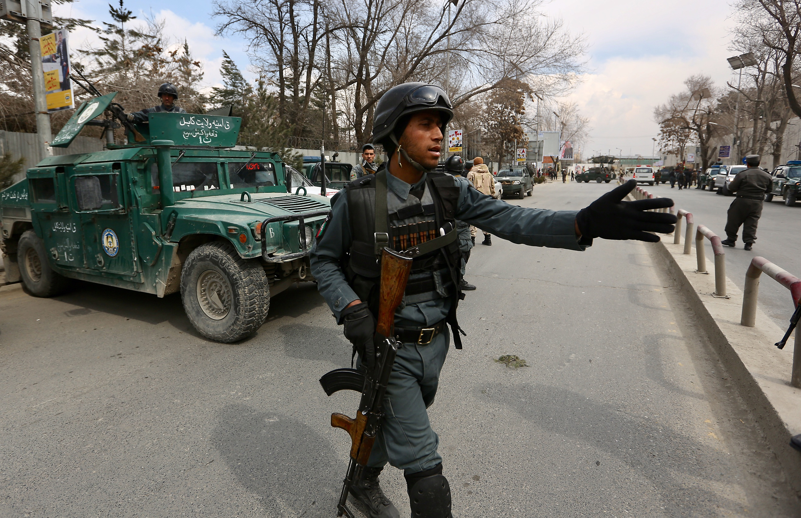 Security forces inspect the site of attack on a military hospital in Kabul, Afghanistan on March 8, 2017. (AP Photo/Rahmat Gul)