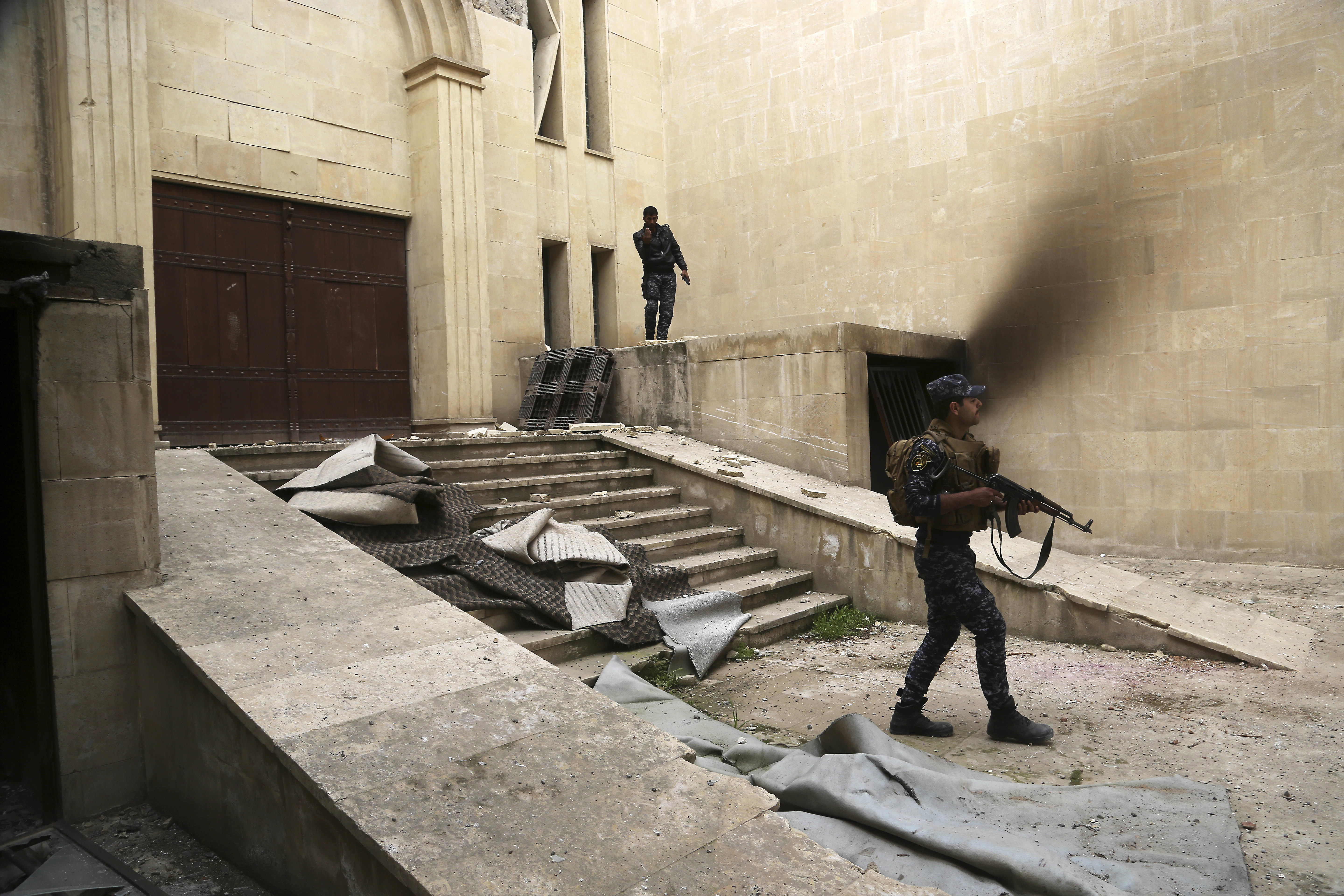 Iraqi federal police inspect Mosul's heavily damaged museum. (AP Photo/Khalid Mohammed)