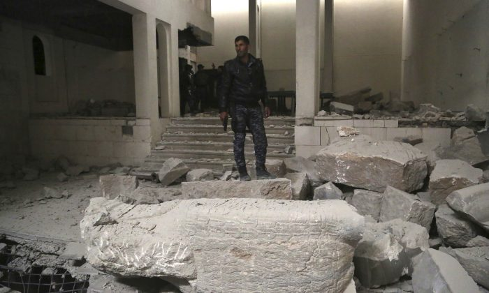 Iraqi federal police inspect the inside of Mosul's heavily damaged museum. (AP Photo/Khalid Mohammed)