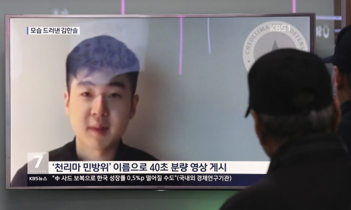 People at a railway station in Seoul, South Korea, watch a TV news program displaying a video in which a man claims to be the son of the slain half brother of North Korea's leader on March 8, 2017. (AP Photo/Lee Jin-man)