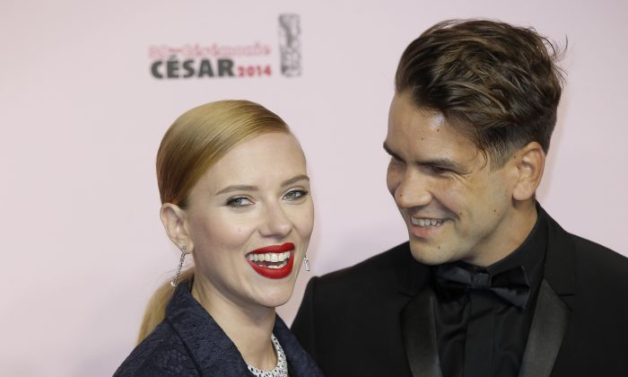 U.S. actress Scarlett Johansson (L) and her partner Romain Dauriac arrive at the 39th French Cesar Awards Ceremony, in Paris on Feb. 28, 2014. (AP Photo/Lionel Cironneau, File)