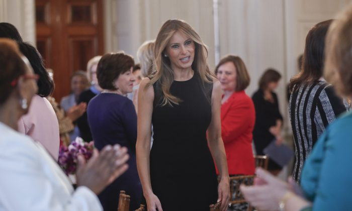 First lady Melania Trump arrives in the State Dining room of the White House in Washington on March 8, 2017, where she hosted a luncheon on International Women's Day.  (AP Photo/Pablo Martinez Monsivais)