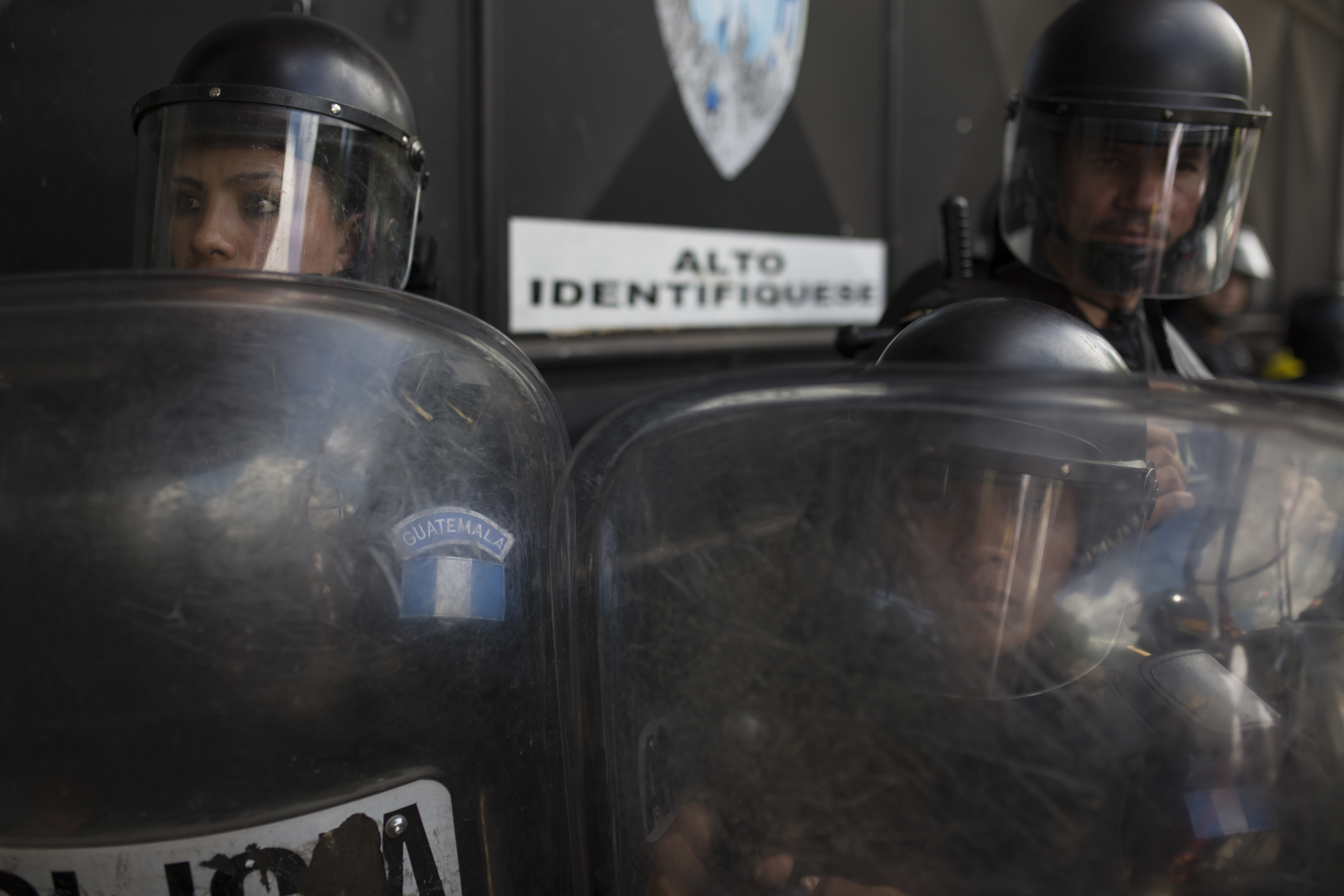National Police safeguard the entrance to the Virgen de la Asunción children's shelter, in San Jose Pinula, Guatemala, on March 8, 2017. (AP Photo/Luis Soto)