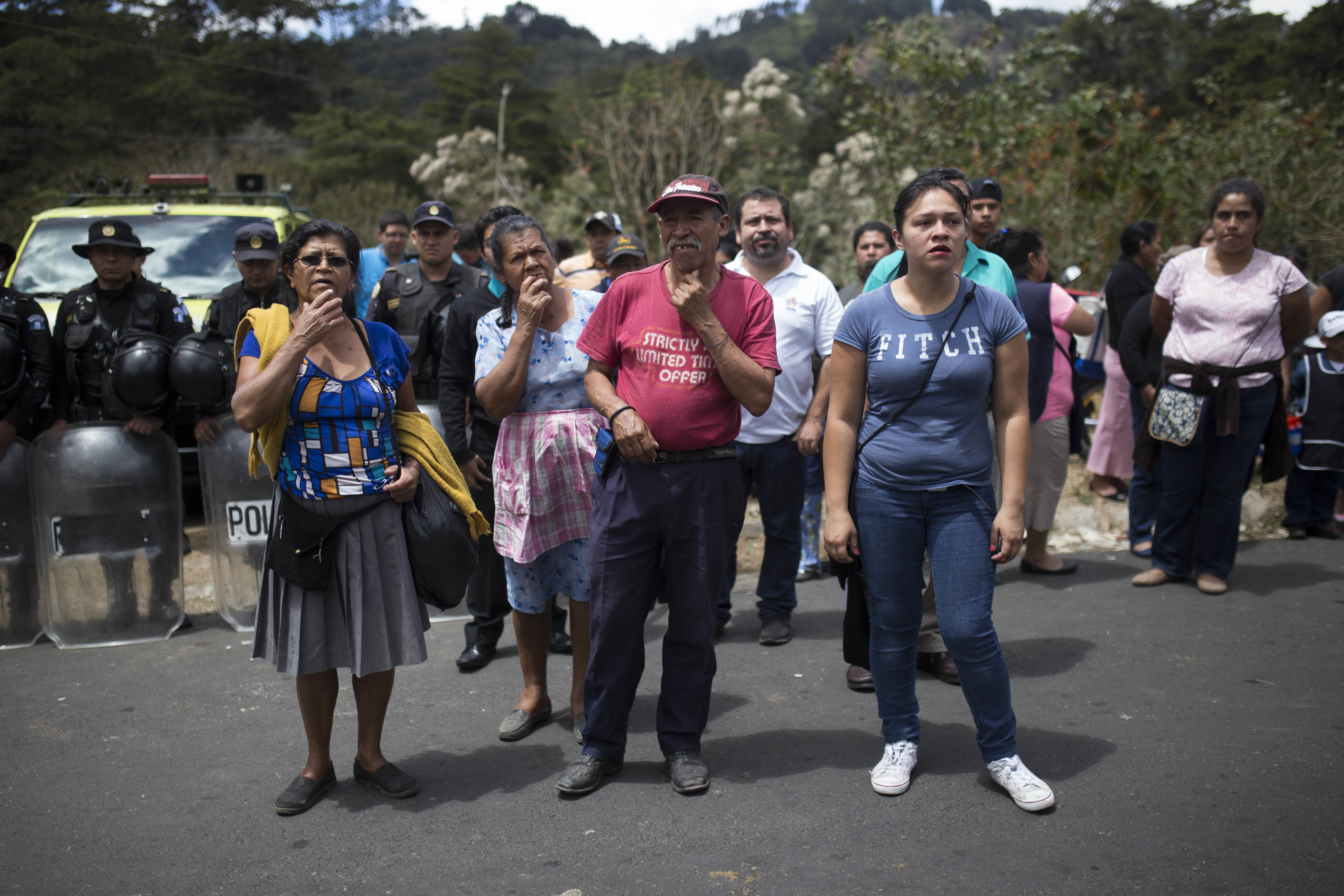 Relatives wait outside the Virgen de la Asunción children's shelter, in San Jose Pinula, Guatemala on March 8, 2017. (AP Photo / Luis Soto)