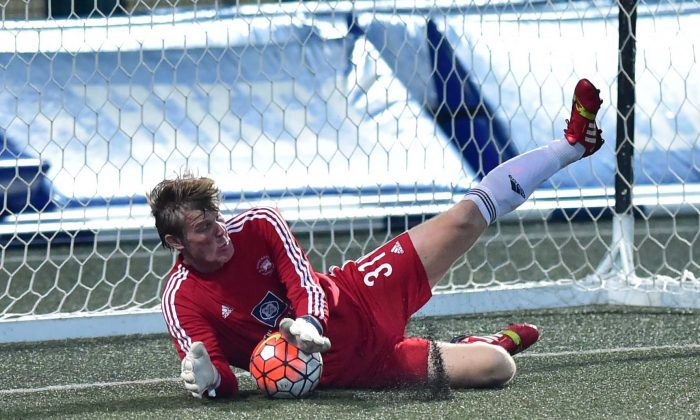 Club Albion's goalie Rudi Hollaender Saves a penalty in their derby match against Club Colts in their Yau Yee League Division 1 match on Sunday March 5, 2017. Albion won the encounter 3-0. (Bill Cox/Epoch Times)