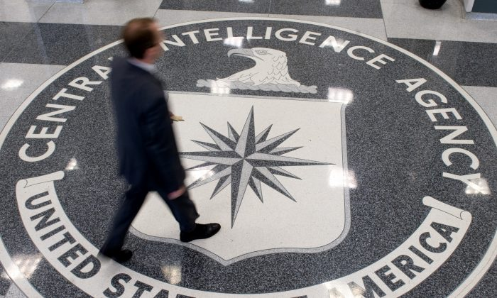 A man crosses the Central Intelligence Agency logo in the lobby of CIA Headquarters in Langley, Va., on Aug. 14, 2008. (SAUL LOEB/AFP/Getty Images)