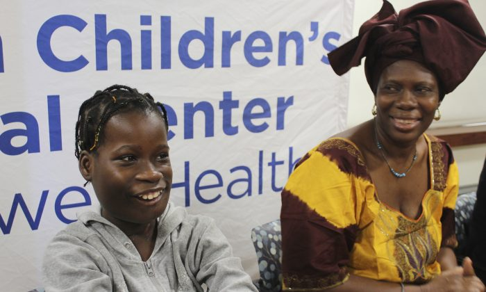 Janet Sylva, left, and her mother, Philomena, smile during a press conference at Cohen Children's Medical Center in New Hyde Park, N.Y., on March 9, 2017. (AP Photo/Frank Eltman).