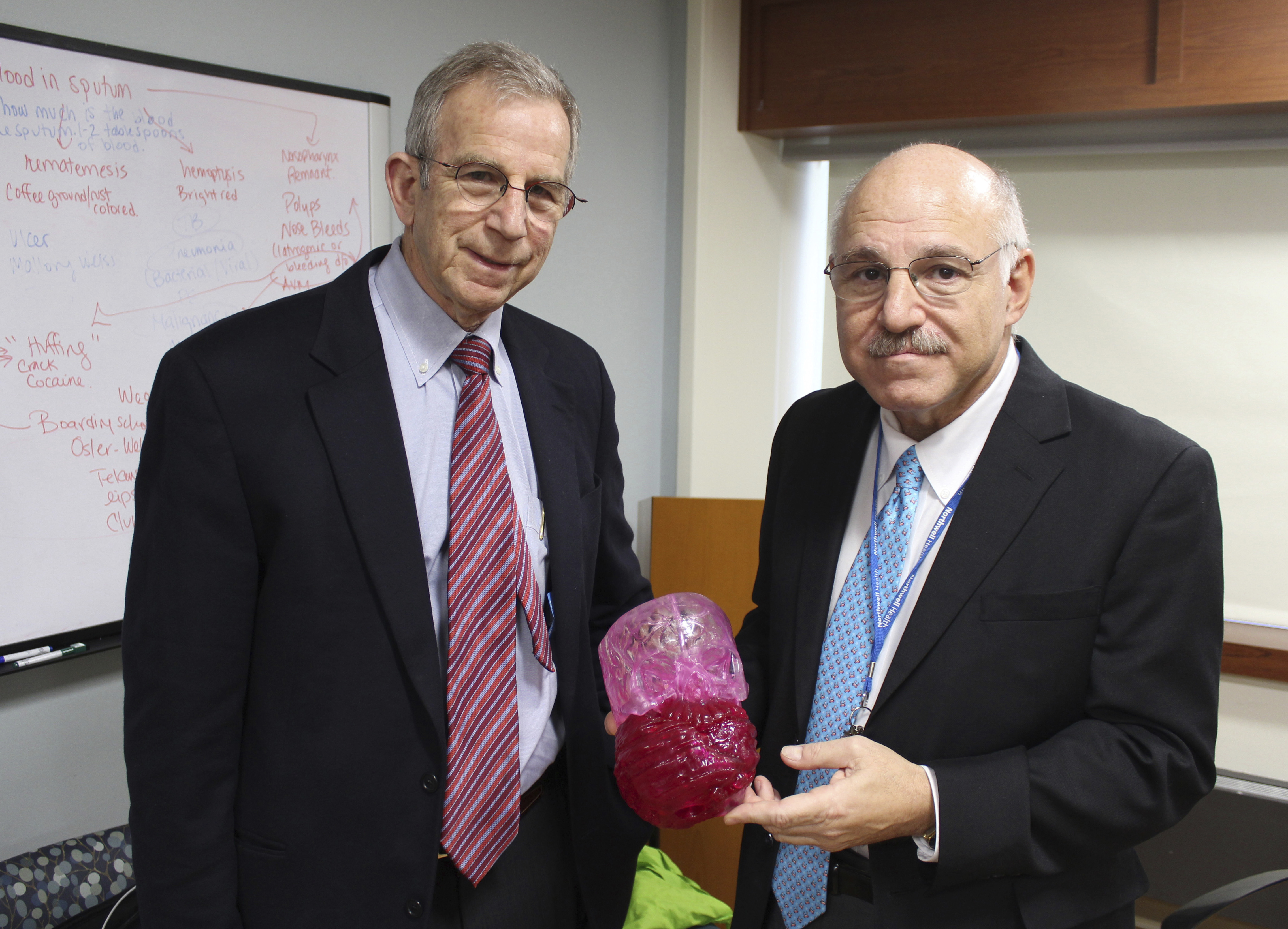 Dr. David Hoffman (L) and Dr. Armen Kasabian, hold a model of a tumor at Cohen's Children's Medical Center in New Hyde Park, N.Y., on March 10, 2017. (AP Photo/Frank Eltman).