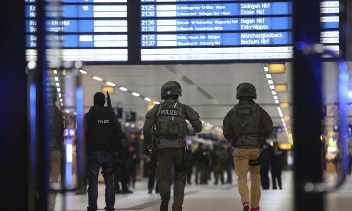 Special police forces walk in the main train station in Duesseldorf, western Germany, on March 9, 2017. (David Young//dpa via AP)