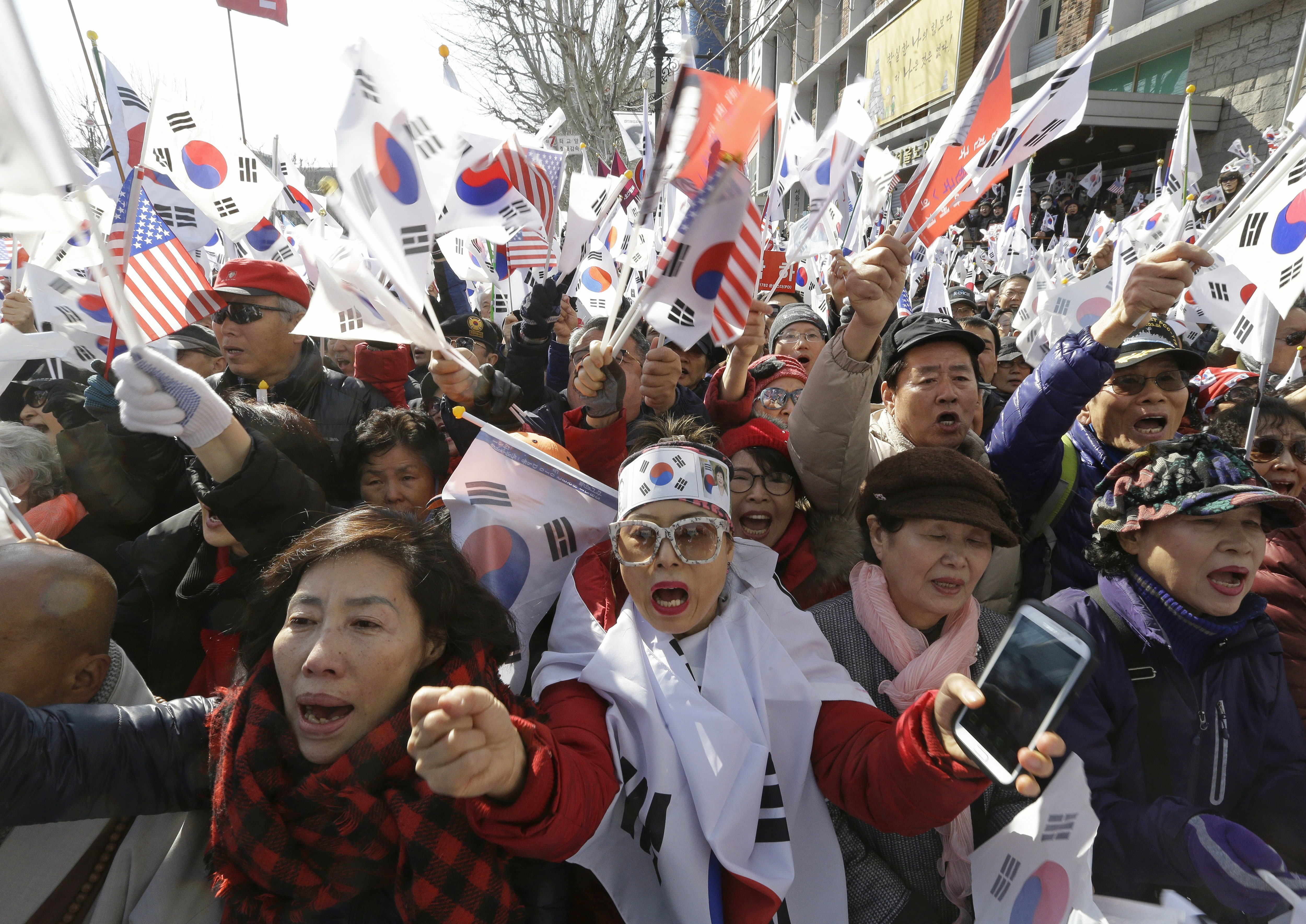 Supporters of South Korean President Park Geun-hye shout slogans during a rally opposing her impeachment near Constitutional Court in Seoul, South Korea on March 10, 2017. (AP Photo/Ahn Young-joon)