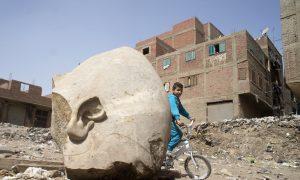 Egypt Archaeologists Discover Massive Statue in Cairo Slum