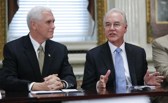 Vice President Mike Pence listens at left as Health and Human Services Secretary Tom Price speaks during a meeting with conservative groups to discuss healthcare, Friday, March 10, 2017, in the Indian Treaty Room of the Eisenhower Executive Office on the White House complex in Washington. (AP Photo/Pablo Martinez Monsivais)