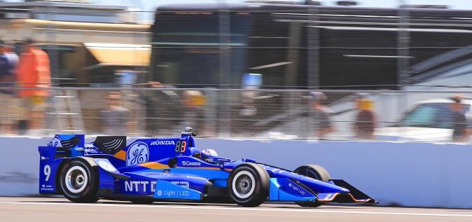 Scott Dixon roars down the front straight during morning practice. (Chris Jasurek/Epoch Times)
