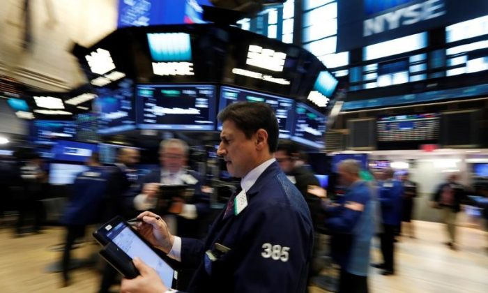 Traders work on the floor of the New York Stock Exchange (NYSE) in New York, U.S., on March 8, 2017. (REUTERS/Brendan McDermid)
