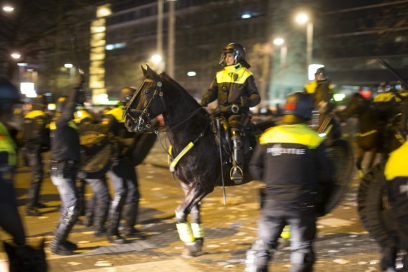 "Dutch riot police battle pro Erdogan demonstrators after riots broke out at the Turkish consulate in Rotterdam, Netherlands on March 12, 2017. Turkish Foreign Minister Mevlut Cavusoglu was due to visit Rotterdam on Saturday to campaign for a referendum next month on constitutional reforms in Turkey. The Dutch government says that it withdrew the permission for Cavusoglu's plane to land because of ""risks to public order and security."" (AP Photo/Peter Dejong)"