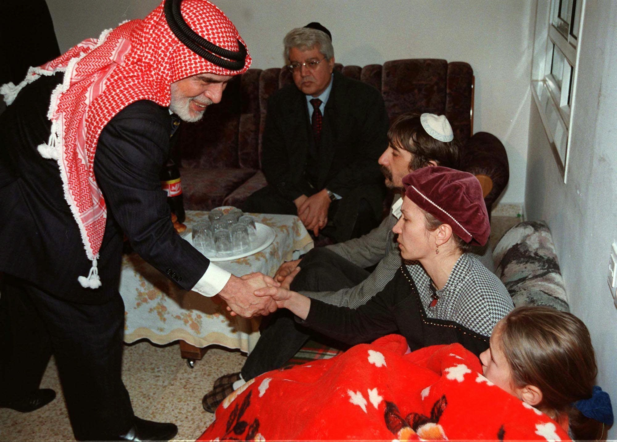 King Hussein of Jordan shakes the hand of members of the Badayev family in Beit Shemesh who are in mourning after their daughter Shiri was killed by a Jordanian soldier on March 16, 1997. (AP PHOTO/GPO/HO)