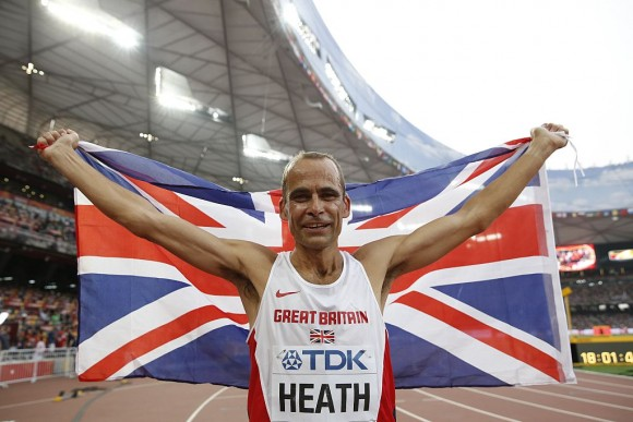 Britain's David Heath celebrates after winning the men's 800 metres masters over-50s athletics ( Adrian Dennis/AFP/Getty Images)