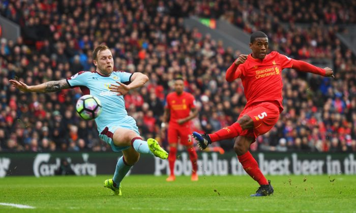 Georginio Wijnaldum of Liverpool shoots past Scott Arfield of Burnley during the English Premier League match between Liverpool and Burnley at Anfield on March 12, 2017. (Michael Regan/Getty Images)