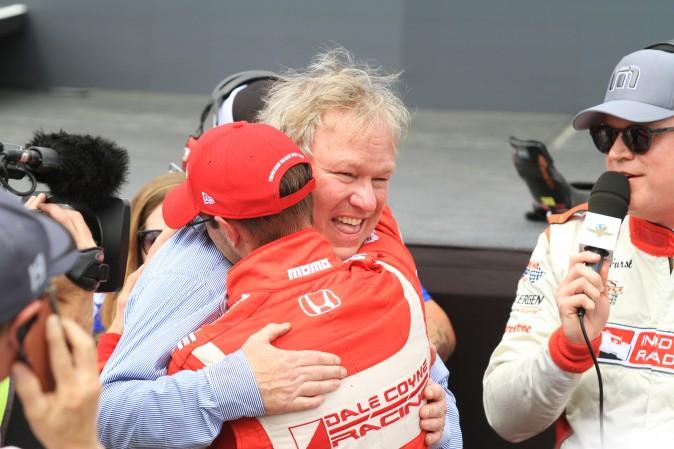 Sebastien Bourdais hugs team owner Dale Coyne after winning the 2017 St. Pete Grand Prix. (Chris Jasurek/Epoch Times)