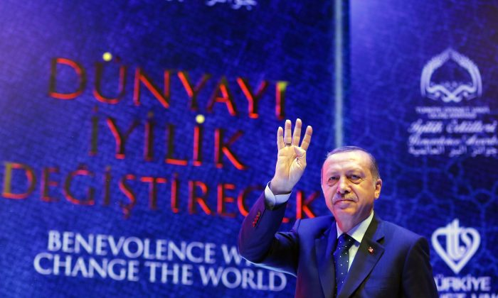 Turkish President Tayyip Erdogan greets the audience as he arrives for a ceremony in Istanbul, Turkey on March 12, 2017. (Kayhan Ozer/Presidential Palace/Handout via REUTERS)
