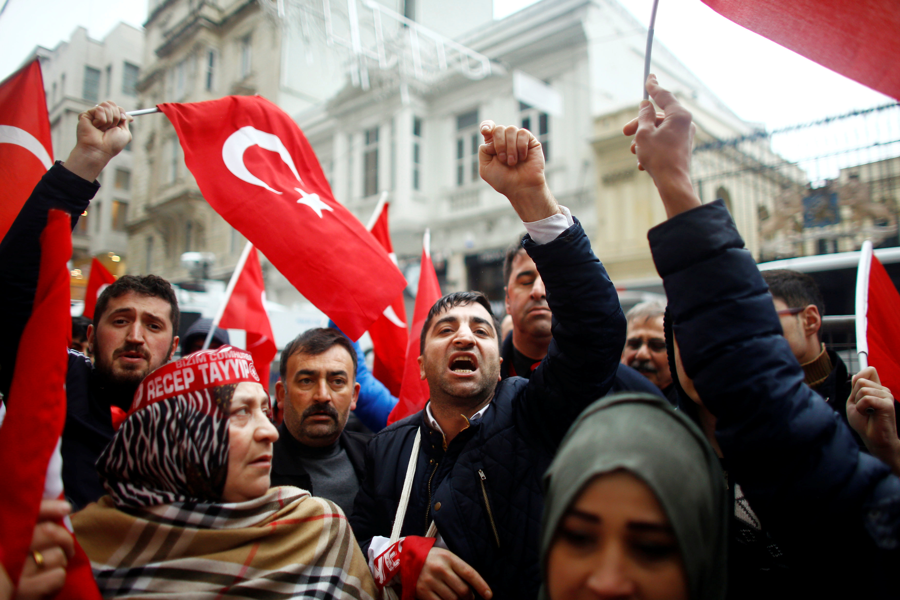 People shout slogans during a protest in front of the Dutch Consulate in Istanbul, Turkey on March 12, 2017. (REUTERS/Osman Orsal)