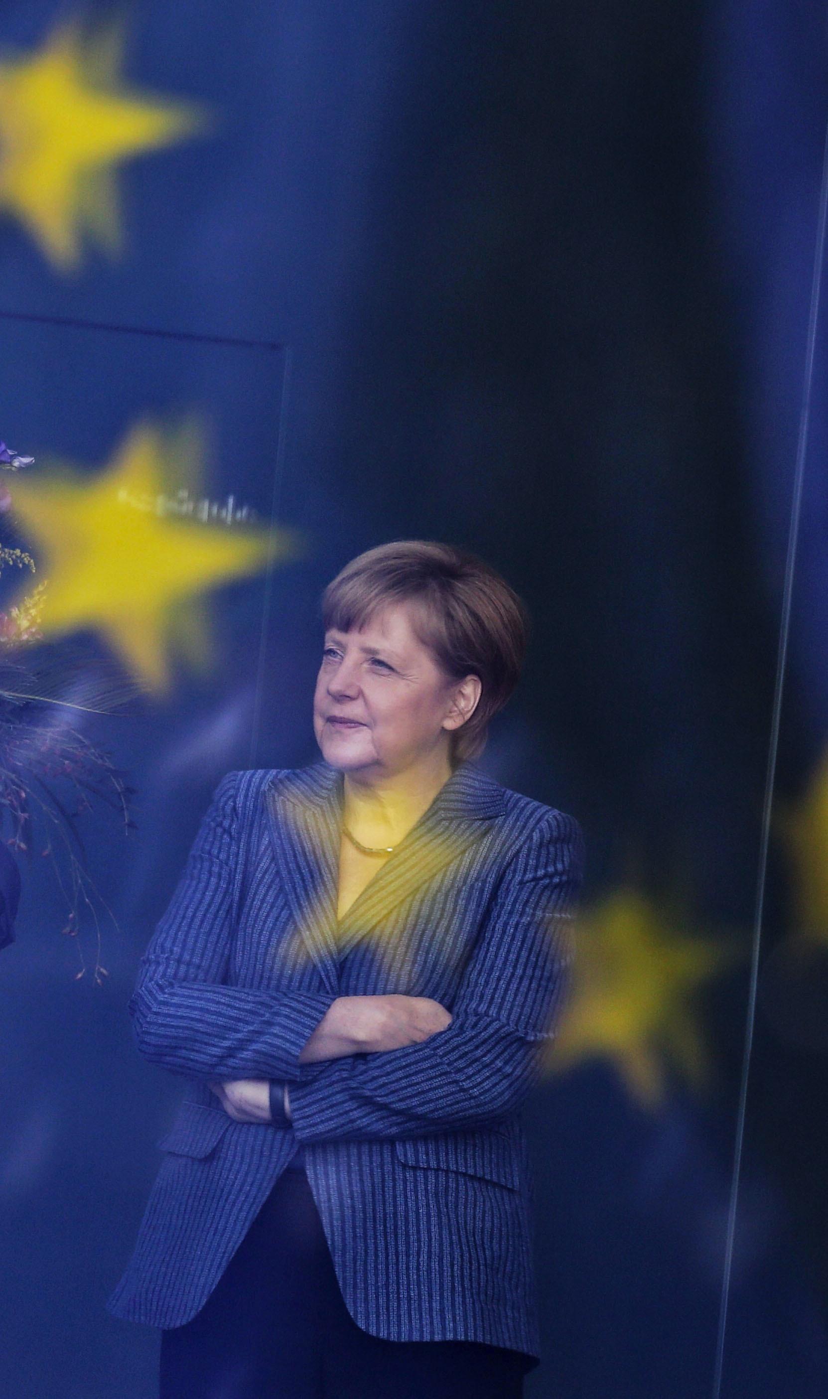 German Chancellor Angela Merkel stands at the chancellery in Berlin on June 2, 2014. (AP Photo/Markus Schreiber, file)