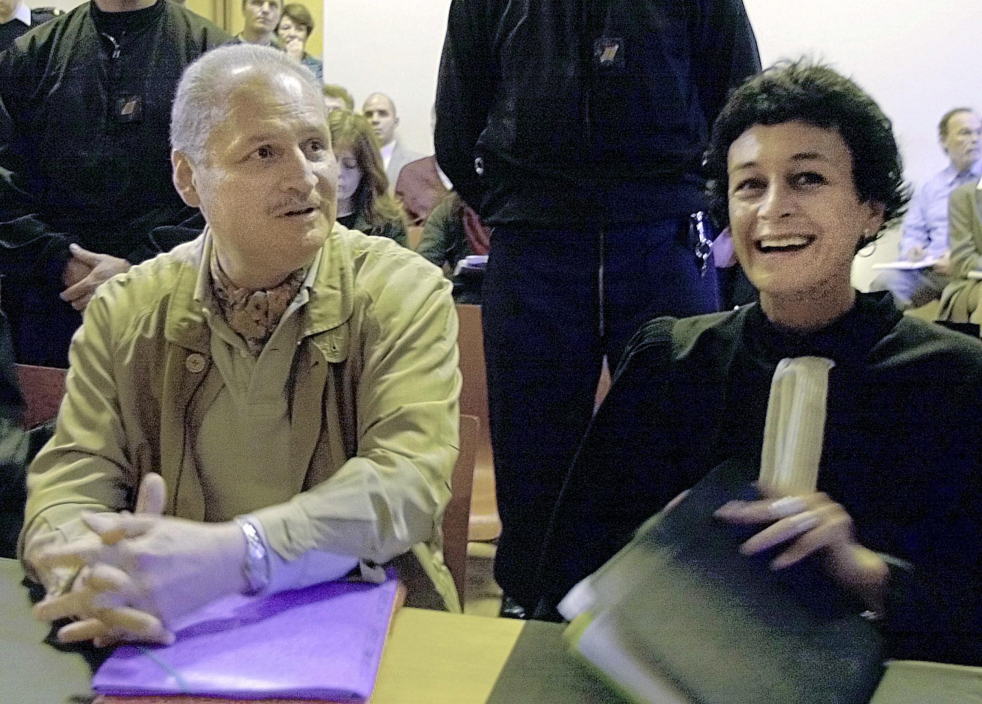 Venezuelan international terrorist Carlos the Jackal whose real name is Ilich Ramirez Sanchez (L) sits with his French lawyer Isabelle Coutant-Peyre in a Paris courtroom on Nov. 28, 2000. (AP Photo/Michel Lipchitz)