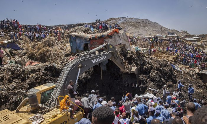 Rescuers work at the scene of a garbage landslide, on the outskirts of the capital Addis Ababa, in Ethiopia on March 12, 2017. (AP Photo/Mulugeta Ayene)
