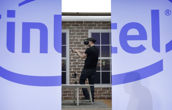 A model demonstrates a Project Alloy all-in-one merged reality headset during an Intel news conference before CES International, in Las Vegas onIn this Wednesday, Jan. 4, 2017, fi. Intel is buying Mobileye in a deal announced Monday, March 13, 2017 and valued at about $14.09 billion, the latest push by a major tech company into autonomous vehicles that could change the way traffic moves globally. (AP Photo/John Locher, File)