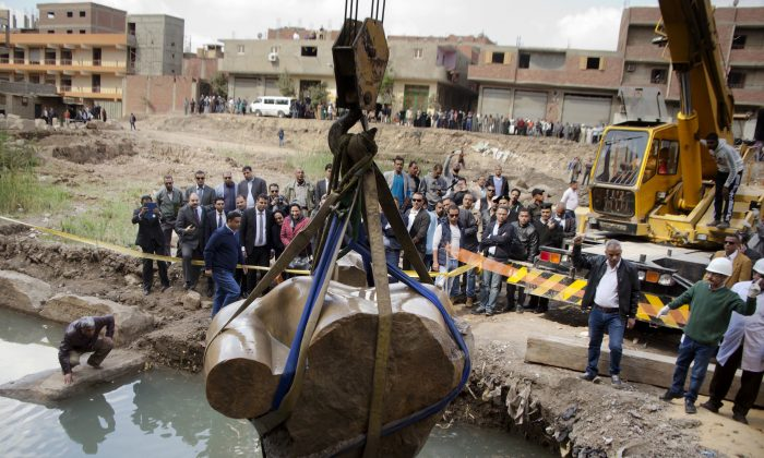 A massive statue, that may be of pharaoh Ramses II, one of the country's most famous ancient rulers, is pulled out of grondwater in a Cairo slum, Egypt on March 13, 2017. (AP Photo/Amr Nabil)