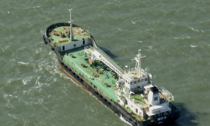The Aris 13 oil tanker is seen from a helicopter in the harbor of Gladstone, Australia on Oct. 27, 2014. (Kevin Finnigan/Tropic Maritime Images via AP)