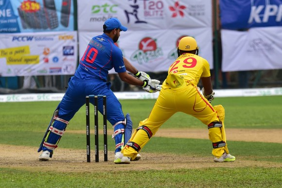 Babar Hayat of Kowloon Cantons hits square during the final of the T20 Blitz against City Kaitak in Hong Kong on Sunday March 12,2017. (Bill Cox/Epoch Times)