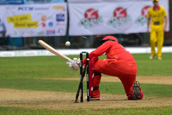 Saeed Ajmal of HKI tried a cheeky deflection to leg but he missed the ball which struck the leg wicket – bowled out. (Bill Cox/Epoch Times)