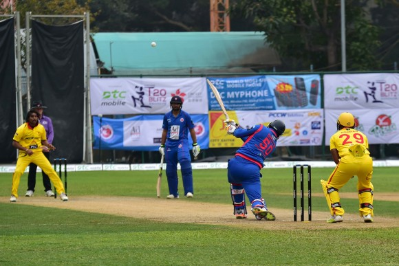 Dwayne Smith of Kowloon Cantons hits straigh during the final of the T20 Blitz against City Kaitak in Hong Kong on Sunday March 12, 2017. Openers Smith and Babar Hayat put on 149 for the 1st wicket in the match.  (Bill Cox/Epoch Times)