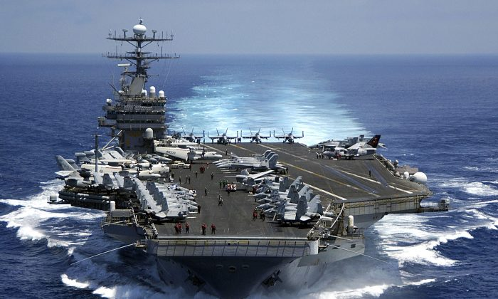 In this handout image provided by the U.S. Navy, the Nimitz-class aircraft carrier USS Carl Vinson (CVN 70) March 15, 2009 in the Indian Ocean. The Nimitz is one of three aircraft carriers now in the under the command of the 7th Fleet. (Petty Officer 2nd Class Dusty Howell/U.S. Navy via Getty Images)