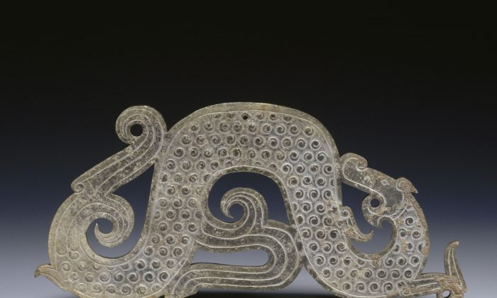 A dragon shaped jade tablet pendant from the Warring States period of China (475–221 B.C.). (Courtesy of Guimet Museum,France)